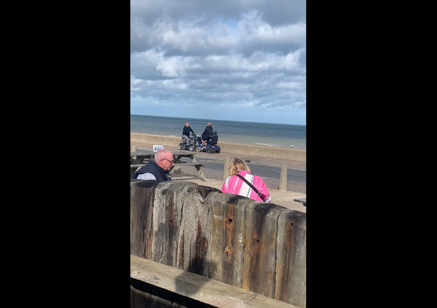 Scooter-Riding Men Engage in Battle Along UK Seafront