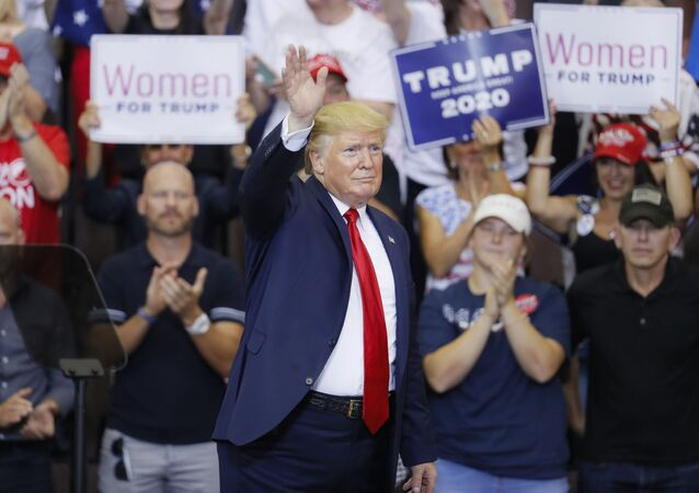 President Donald Trump waves to the crowd before exiting a campaign rally at U.S. Bank Arena, Thursday, Aug. 1, 2019, in Cincinnati.