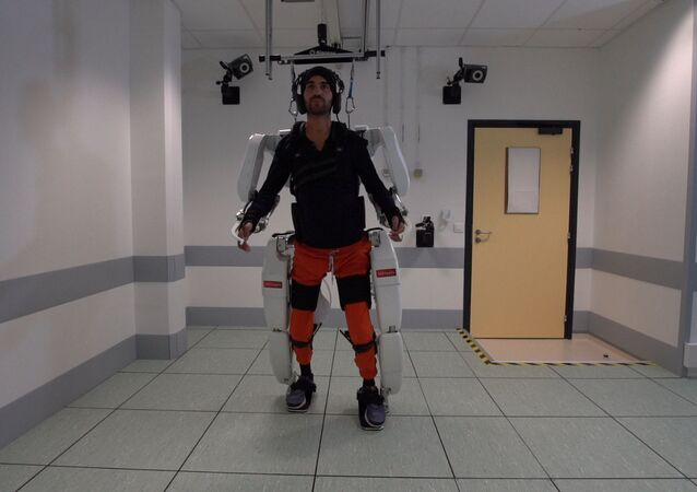 A patient with tetraplegia walks using an exoskeleton in Grenoble, France, in February 2019