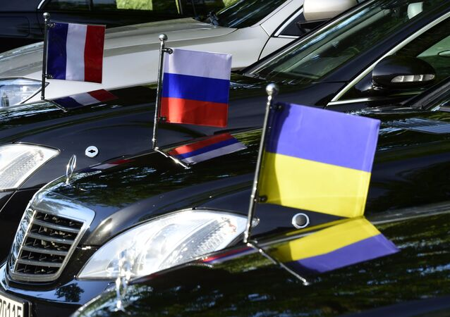Flags mounted on the official cars are seen in Berlin on June 11, 2018, during a Normandy Format meeting of foreign ministers from France, Germany, Ukraine and Russia on the conflict in Ukraine.
