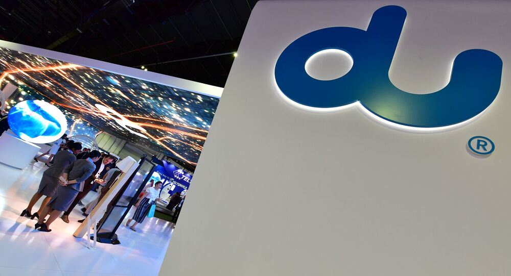 A DU logo, an emiratee phone network, is seen at the Gitex 2017 exhibition at the Dubai World Trade Center in Dubai on October 8, 2017.
