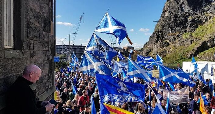 A crowd marches through the streets of Edinburgh on Saturday in support of Scottish independence.