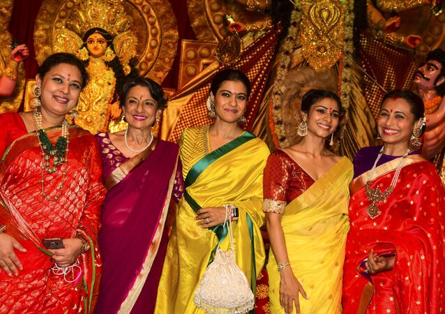 Bollywood actresses Sharbani Mukherjee (L), Tanuja (2L), Kajol Devgan (C), Tanisha Mukherjee (2R) and Rani Mukherjee (R) pose for photographs during 'Durja Puja' celebrations at the 72nd North Bombay Sarbojanin Durga Puja Samiti festival in Mumbai on October 6, 2019.