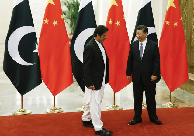 China's President Xi Jinping meets Pakistan's Prime Minister Imran Khan at the Great Hall of the People in Beijing, Friday, Nov. 2, 2018
