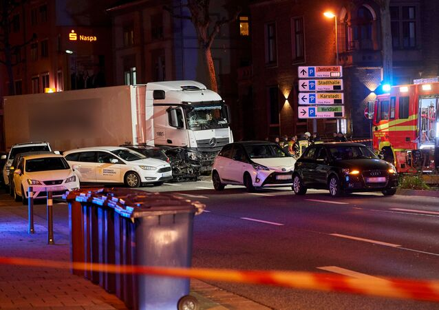 Picture shows the scene, codoned off by police, where a stolen truck crashed in to cars stopped at a red light in Limburg, western Germany, on October 7, 2019, leaving several people injured