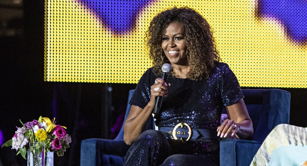 Michelle Obama and Gayle King seen at the 2019 Essence Festival at the Mercedes-Benz Superdome, Saturday, July 6, 2019, in New Orleans