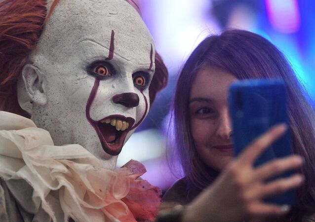 A visitor and a cosplayer at the IgroMir 2019 exhibition and the Comic Con Russia 2019 festival at the International Crocus Expo Exhibition Centre in Moscow.