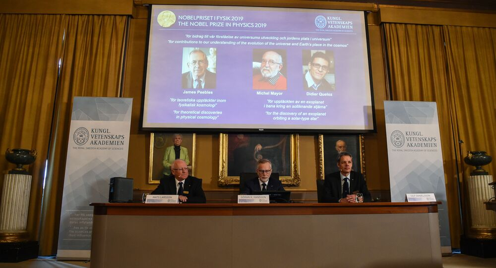 Members of the Nobel Committee for Physics (Bottom L-R) Chair of the Nobel Committee Mats Larsson, Secretary General of the Academy Goran K Hansson, and Ulf Danielsson sit in front of a screen displaying the names of the winners of the 2019 Nobel Prize in Physics (Up L-R) Canadian-American James Peebles, Swiss scientists Michel Mayor and Didier Queloz, at the Royal Swedish Academy of Sciences on October 8, 2019 in Stockholm