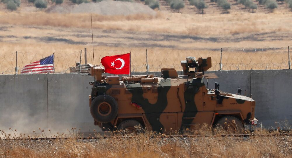 A Turkish military vehicle returns after a joint U.S.-Turkey patrol in northern Syria, as it is pictured from near the Turkish town of Akcakale, Turkey, September 8, 2019