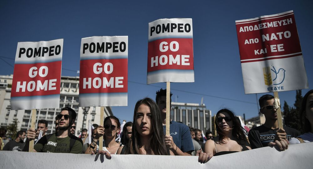 Communist-affiliated protesters hold placards as they take part in a demonstration to protest against the visit of US Secretary of State Mike Pompeo in Athens on October 5, 2019.