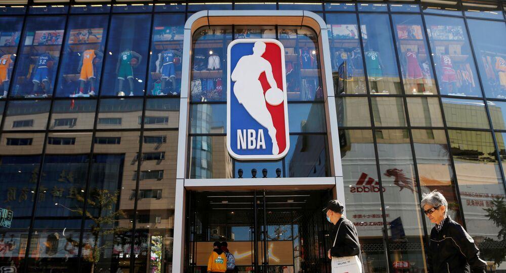 People enter a flagship NBA store at the Wangfujing shopping street in Beijing, China October 8, 2019.