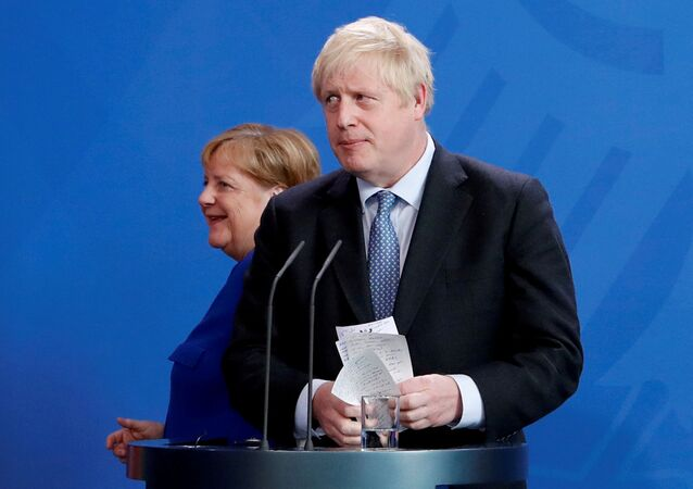 Britain's Prime Minister Boris Johnson holds his notes as he attends a news conference with German Chancellor Angela Merkel at the Chancellery in Berlin, Germany August 21, 2019.