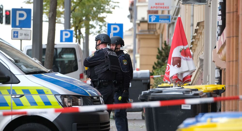 Policemen secure the area around the site of a shooting in Halle an der Saale, eastern Germany, on October 9, 2019.