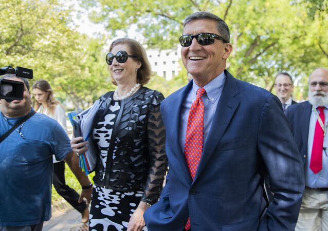 Michael Flynn, President Donald Trump's former national security adviser, leaves the federal court with his lawyer Sidney Powell, left, following a status conference with Judge Emmet Sullivan, in Washington, Tuesday, Sept. 10, 2019