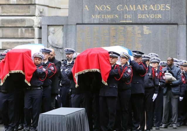 Police officers hold the coffins of their fallen colleagues during a ceremony at The Prefecture de Police de Paris (Paris Police Headquarters) in Paris on October 8, 2019, held to pay respects to the victims of an attack at the prefecture on October 4, 2019.