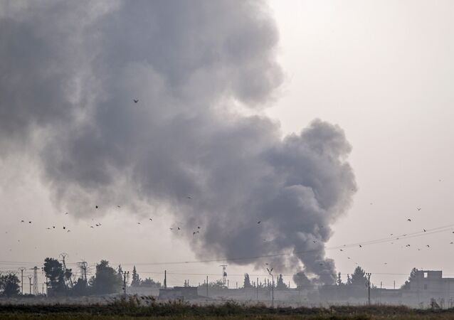 Smoke rises from the Syrian town of Tal Abyad after Turkish bombings, in a picture taken from the Turkish side of the border near Akcakale in the Sanliurfa province on October 9, 2019.