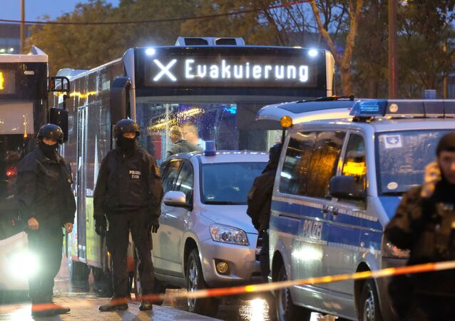 A bus reading evacuation is escorted by the police past the site of a shooting in Halle an der Saale, eastern Germany, on October 9, 2019.