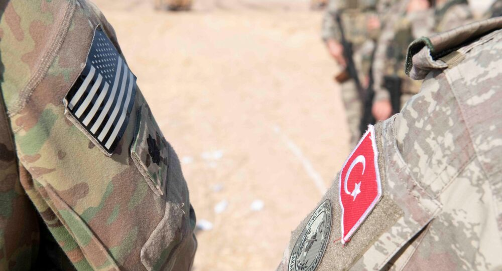 U.S. and Turkish military forces conduct a joint ground patrol in northeast Syria