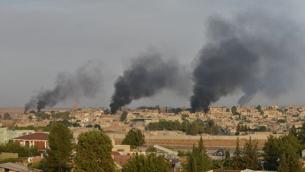 Smoke rises from the Syrian border town of Ras al-Ain as it is pictured from the Turkish town of Ceylanpinar in Sanliurfa province, Turkey, October 9, 2019 - Sputnik International