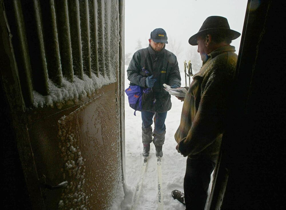 A postman brings mail to residents of Le Markstein in the Vosges mountains in France