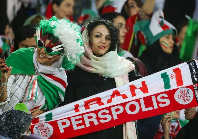 Iranian women pose for a picture during the World Cup Qatar 2022 Group C qualification football match between Iran and Cambodia at the Azadi stadium in the capital Tehran on October 10, 2019.