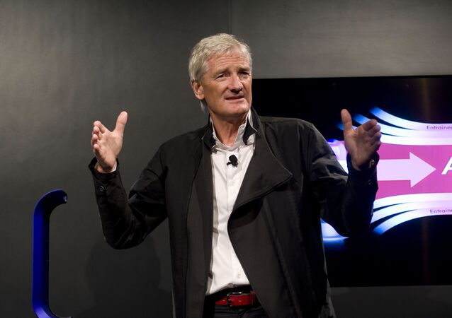 In this Wednesday, Sept., 14, 2011 file photo, Inventor James Dyson launches the Dyson DC41 Ball vacuum and the Dyson Hot heater fan on in New York.