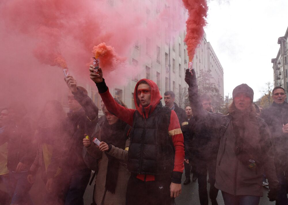 People burn flares during a rally against the approval of the so-called Steinmeier Formula, in Kiev, Ukraine.