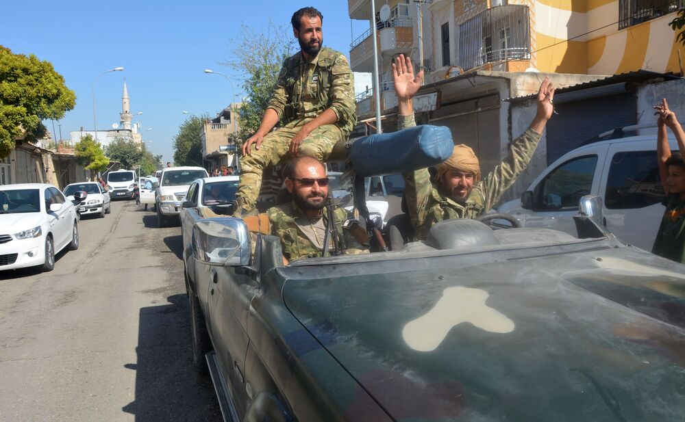 The Free Syrian Army forces are taking a ride along the Turkish-Syrian border in Akchakala.