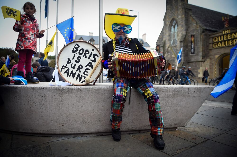 A demonstrator plays the accordion as he waits to attend a pro-independence march from Holyrood to the Meadows in Edinburgh, Scotland on October 5, 2019.