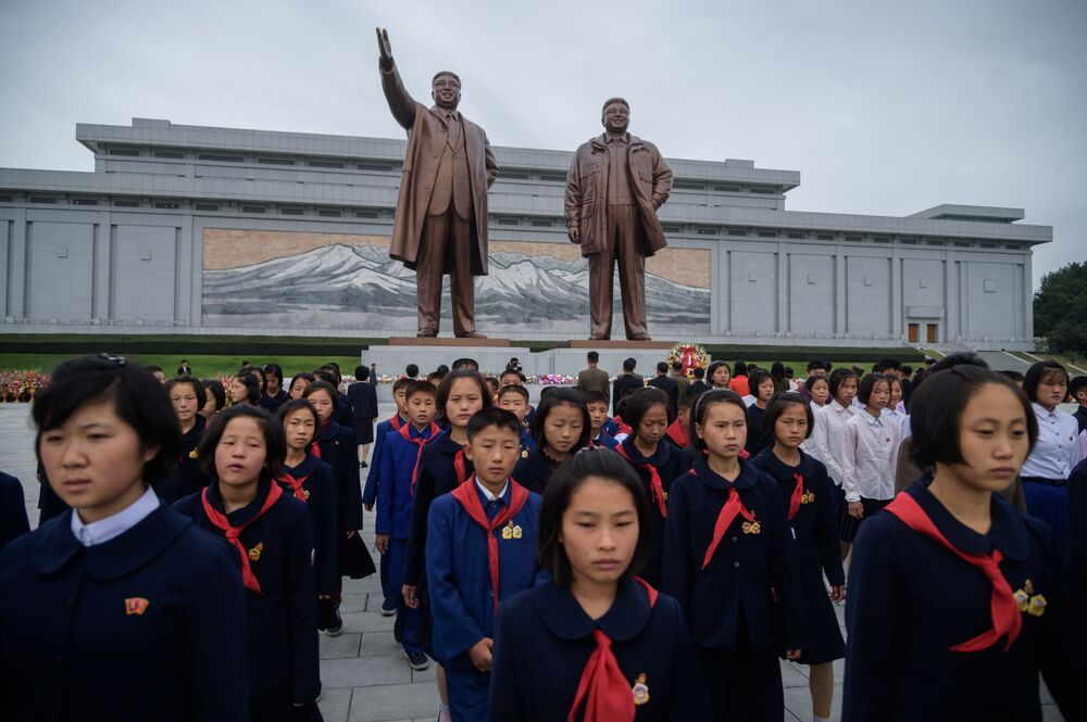Students visit the statues of late North Korean leaders Kim Il Sung and Kim Jong Il on Mansu Hill to pay their respects on the occasion of the 74th founding anniversary of the Workers' Party of Korea on October 10, 2019.
