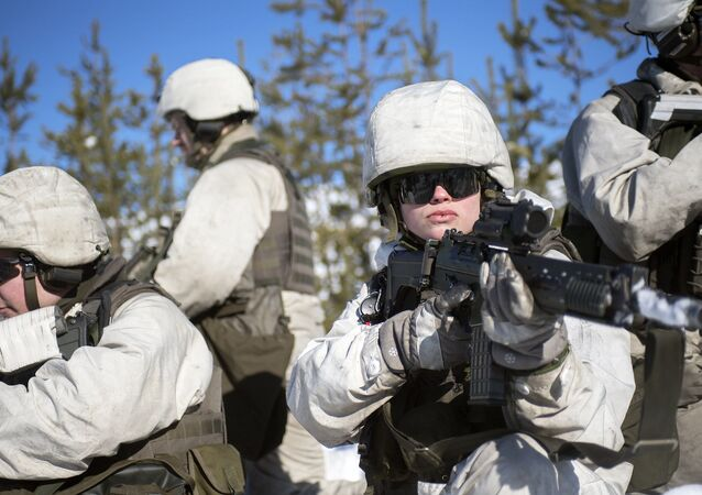 Swedish troops prepare to conduct a perimiter patrol during Exercise Winter Sun in Boden, Sweden on 15th March 2018