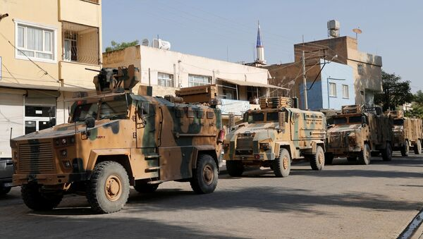 Turkish military vehicles drive to cross into Syria in the Turkish border town of Ceylanpinar in Sanliurfa province, Turkey, October 11, 2019 - Sputnik International
