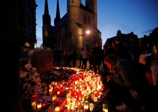 Mourners gather at the market square in Halle, Germany on 10 October 2019, after two people were killed in a shooting