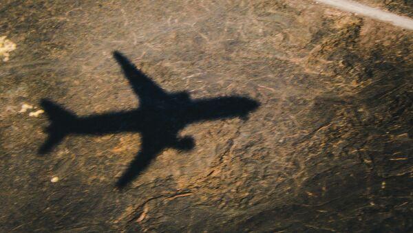 Plane Shadow - Sputnik International