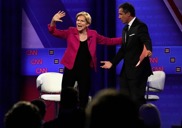 Democratic 2020 U.S. presidential candidate Senator Elizabeth Warren (D-MA) gestures next to CNN's Chris Cuomo during a televised townhall on CNN dedicated to LGBTQ issues in Los Angeles, California, U.S. October 10, 2019