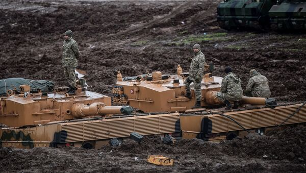German-made Turkish Leopard 2A4 battle tanks are stationed in a field near the Syrian border at Hassa, in Hatay province on 25 January 2018, as part of operation Olive Branch. - Sputnik International