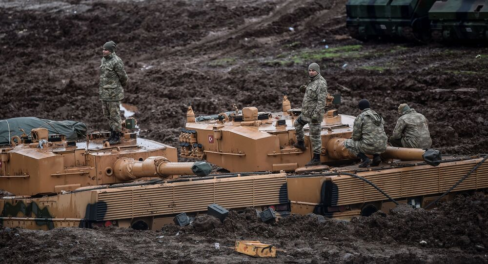 Turkish, German-made Leopard 2A4 battle tanks, are stationed in a field near the Syrian border at Hassa, in Hatay province on January 25, 2018. File photo.