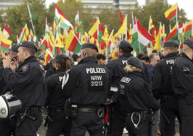 Police secures a protest against the Turkish invasion in Kurdish territories in northern Syria in Cologne, Germany