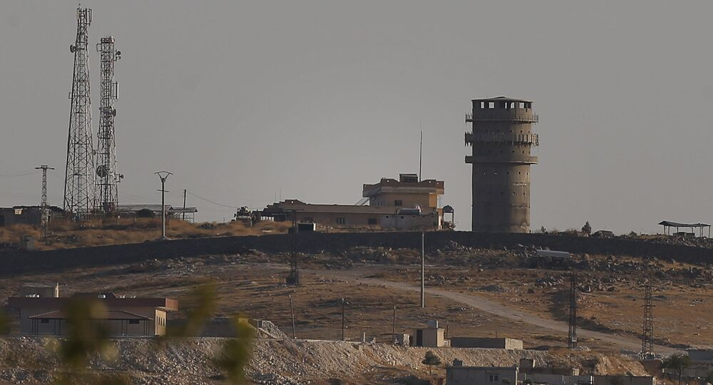 In this photo taken from the Turkish side of the border between Turkey and Syria, in Suruc, southeastern Turkey, a U.S forces outpost is seen on a hilltop outside Ayn Al Arab or Kobani, Syria, Saturday, Oct. 12, 2019.