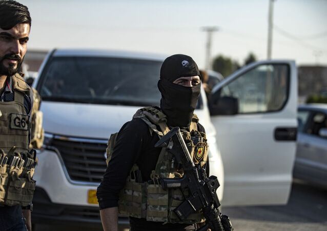 Members of the special forces of the Kurdish-led Syrian Democratic Forces (SDF) are pictured during preparations to join the front against Turkish forces, on October 10, 2019