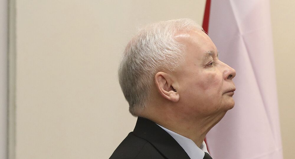 The ruling party leader Jaroslaw Kaczynski holds his ballot at a polling station in Warsaw, Poland