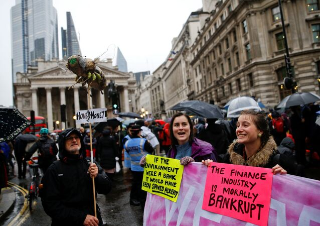 Protesters chant slogans at they block the road during an Extinction Rebellion demonstration at Bank, in the City of London, Britain October 14, 2019