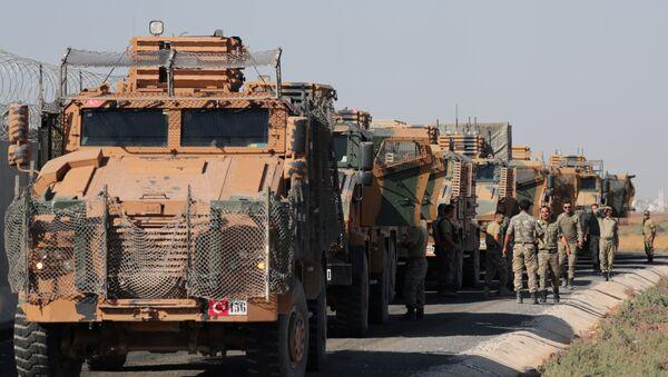 Turkish soldiers stand near military trucks in the village of Yabisa, near the Turkish-Syrian border, Syria, October 12, 2019. REUTERS/Khalil Ashawi - Sputnik International