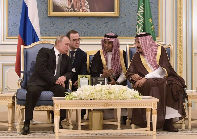 Russian President Vladimir Putin and Saudi Arabia's King Salman bin Abdulaziz Al Saud attend a meeting at the Saudi Royal palace in Riyadh, Saudi Arabia