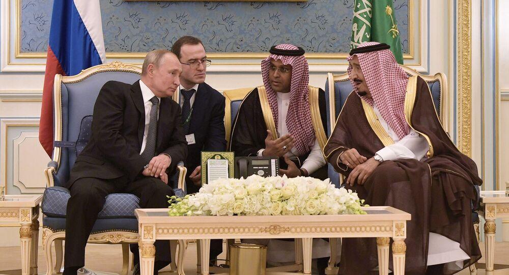 Russian President Vladimir Putin and Saudi Arabia's King Salman bin Abdulaziz Al Saud attend a meeting at the Saudi Royal palace in Riyadh, Saudi Arabia