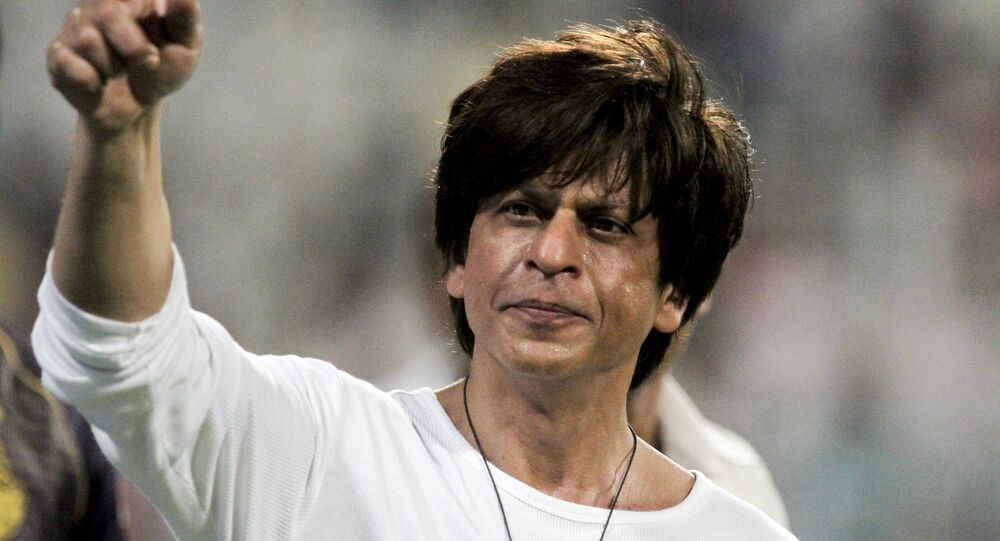 Shah Rukh Khan, Bollywood actor and Kolkata Knight Riders co-owner gestures the people in the stadium after his team won the match against Mumbai Indians at the VIVO IPL cricket T20 in Kolkata, India, Sunday, April 28, 2019