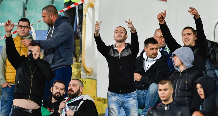 Bulgarian fans react during a temporary interruption of the Euro 2020 qualification game with England in Sofia