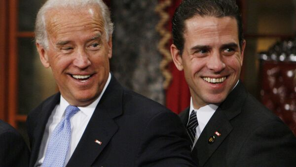 Vice President-elect, Sen. Joe Biden, D-Del., left, stands with his son Hunter during a re-enactment of the Senate oath ceremony, Tuesday, 6 January 2009, in the Old Senate Chamber on Capitol Hill in Washington - Sputnik International