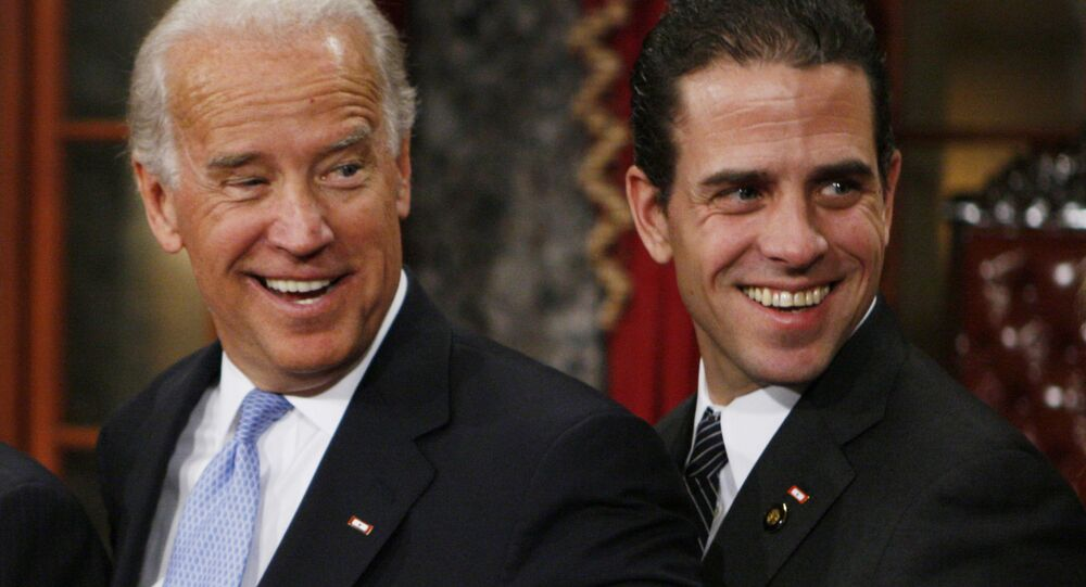 Vice President-elect, Sen. Joe Biden, D-Del., left, stands with his son Hunter during a re-enactment of the Senate oath ceremony, Tuesday, 6 January 2009, in the Old Senate Chamber on Capitol Hill in Washington