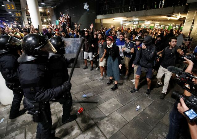Protesters clash with police officers as they demonstrate at the airport, after a verdict in a trial over a banned independence referendum, in Barcelona, Spain October 14, 2019